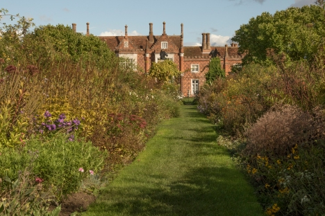 View towards west facade of Helmingham Hall along herbaceous border